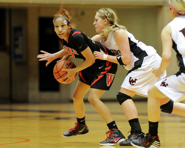 Wagner's Aundrea Davis (12) protects the ball from Churchill's Leslie Vorpahl (right) during a UIL 5A girls third-round playoff game between the Thunderbirds and the Chargers at the UTSA Convocation Center on Feb. 20, 2012. Photo: John Albright / For The Express-News