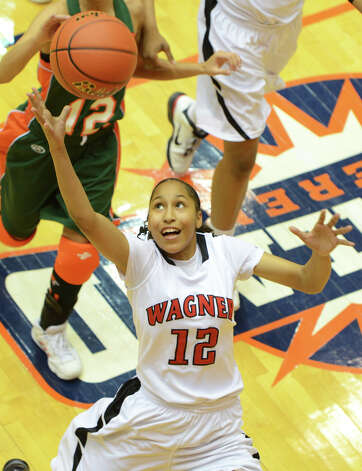 Wagner junior Aundrea Davis (12) grabs a rebound during the Region IV-5A girls semifinals game between the Thunderbirds and the Harlingen South in the UTSA Convocation Center on Feb. 25, 2011. Photo: JOHN ALBRIGHT, For The Express-News / San Antonio Express-News