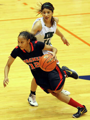 Wagner's Aundrea Davis drives around Corpus Christi King's Melanie Cavazos during first half action  of the Region IV-5A final Saturday, Feb. 26, 2011 at the UTSA Convocation Center. Photo: EDWARD A. ORNELAS, San Antonio Express-News / eaornelas@express-news.net