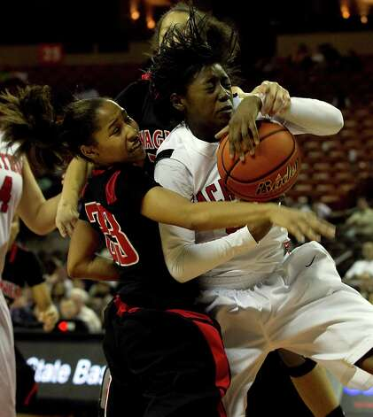 Wagner guard Adriane Davis (left) and Alexis Jones of Irving MacArthur fight for possession of a rebound during a 5A semifinal round at the Erwin Center in Austin on Friday, March 04, 2011. Photo: Larry Kolvoord, Austin American-Statesman