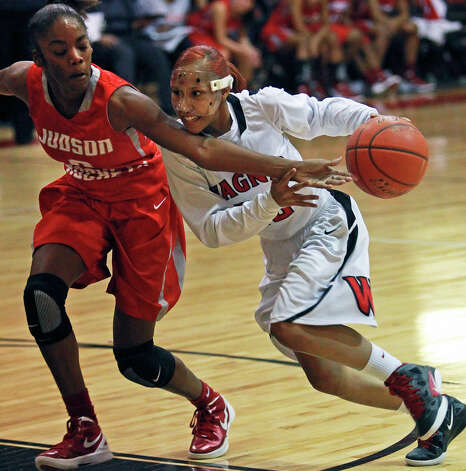 Wagner guard Aundrea Davis drives to the bucket as LaQeisha Brown tries a reach in to stop her as Wagner plays Judson at the Wagner gym on Jan.  13, 2012. Photo: TOM REEL, San Antonio Express-News / © 2012 San Antonio Express-News  MAGS OUT; TV OUT; NO SALES; SAN ANTONIO OUT; AP MEMBERS ONLY; MANDATORY CREDIT; EFE OUT