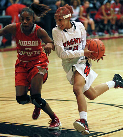 Wagner's Aundrea Davis flies to the hoop against LaQeisha Brown as Wagner plays Judson at the Wagner gym on Jan. 13, 2012. Photo: TOM REEL, San Antonio Express-News / © 2012 San Antonio Express-News  MAGS OUT; TV OUT; NO SALES; SAN ANTONIO OUT; AP MEMBERS ONLY; MANDATORY CREDIT; EFE OUT