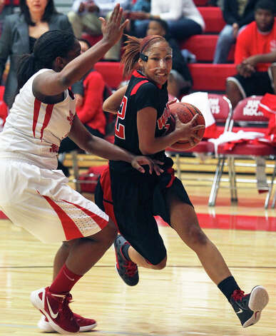 Wagner guard  Aundrea Davis breaks to the basket as Wagner plays Judson in girls basketball at the Judson gym on Jan. 31, 2012. Photo: TOM REEL, San Antonio Express-News / © 2012 San Antonio Express-News  MAGS OUT; TV OUT; NO SALES; SAN ANTONIO OUT; AP MEMBERS ONLY; MANDATORY CREDIT; EFE OUT