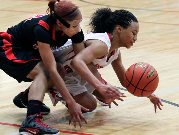 Wagner guard Aundrea Davis (left) pressures the ball away from Samantha Allen as Wagner plays Judson at the Judson gym on Jan. 31, 2012. Photo: TOM REEL, San Antonio Express-News / © 2012 San Antonio Express-News  MAGS OUT; TV OUT; NO SALES; SAN ANTONIO OUT; AP MEMBERS ONLY; MANDATORY CREDIT; EFE OUT