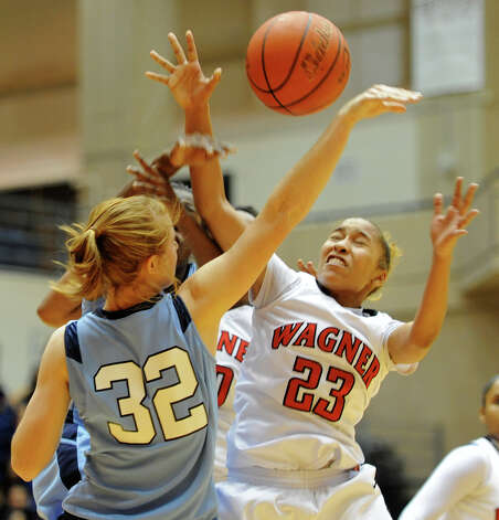 Wagner's Adriane Davis (23) and Johnson's Morgan Stearns (32) battle for a loose ball during a UIL 5A girls bidistrict playoff game at the UTSA Convocation Center on Feb. 13, 2012. Photo: John Albright / For The Express-News