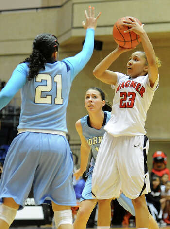 Wagner's Adriane Davis (23) gets off a shot in the lane during a UIL 5A girls bidistrict playoff game between Johnson and Wagner at the UTSA Convocation Center on Feb. 13, 2012. Photo: John Albright / For The Express-News