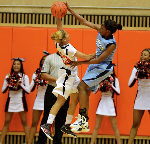 Johnson's Erica Sanders (right) blocks the shot of Wagner's Adriane Davis (23) during a UIL 5A girls bidistrict playoff game at the UTSA Convocation Center on Feb. 13, 2012. Photo: John Albright / For The Express-News