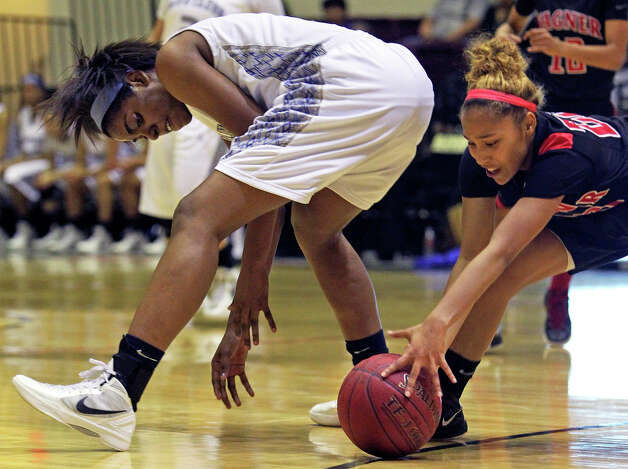 Wagner guard Adriane Davis sneaks behind to steal the ball from Aleeya Harris as Wagner defeats Jay in girls playoff action at Littleton Gym  on Feb. 17, 2012. Photo: TOM REEL, San Antonio Express-News / San Antonio Express-News