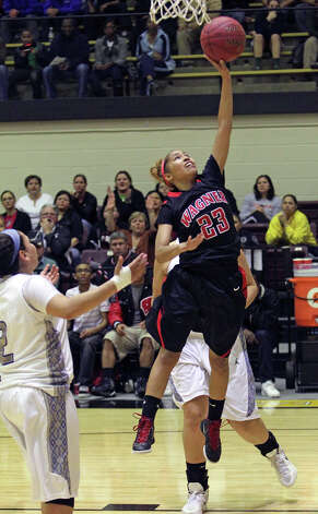 Wagner guard Adriane Davis busts loose for a clean layup as Wagner defeats Jay in girls playoff action at Littleton Gym  on Feb. 17, 2012. Photo: TOM REEL, San Antonio Express-News / San Antonio Express-News
