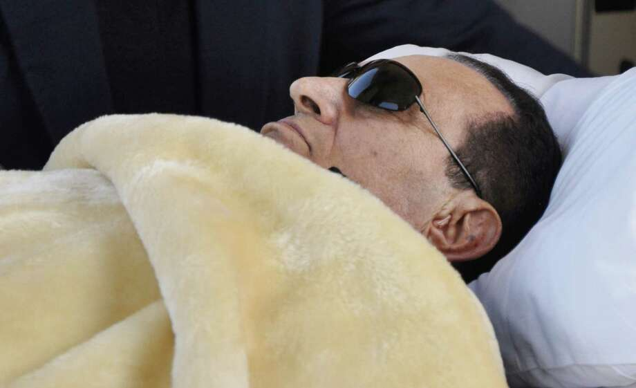 Former Egyptian president Hosni Mubarak reportedly is near death and is subsisting on yogurt and liquids, according to a security official. Photo: Mohammed Al-Law, AP / AP
