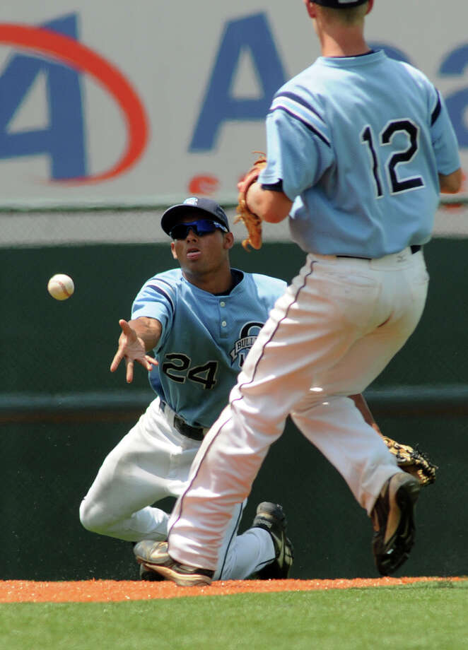 Sweeny junior shortstop Jordan Limas, left, flips the ball to senior 2nd baseman Michael Ferrel (#12) to start a double play to end the top of the 7th inning in the Bulldog's 10-3 loss to the West Trojans in the Class 3A state semifinal matchup at UFCU Disch-Falk Field in Austin on Wednesday. Photo: Jerry Baker, For The Chronicle