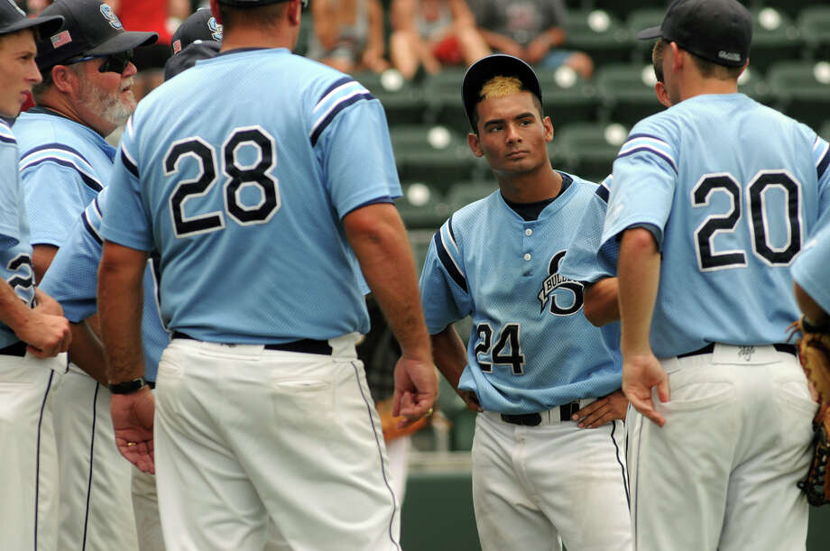 Sweeny junior pitcher/shortstop Jordan Limas (#24) shows his look of dejection between innings of the Bulldog's 10-3 loss at the hands of the West Trojans in their Class 3A state semifinal matchup at UFCU Disch-Falk Field in Austin on Wednesday. Photo: Jerry Baker, For The Chronicle