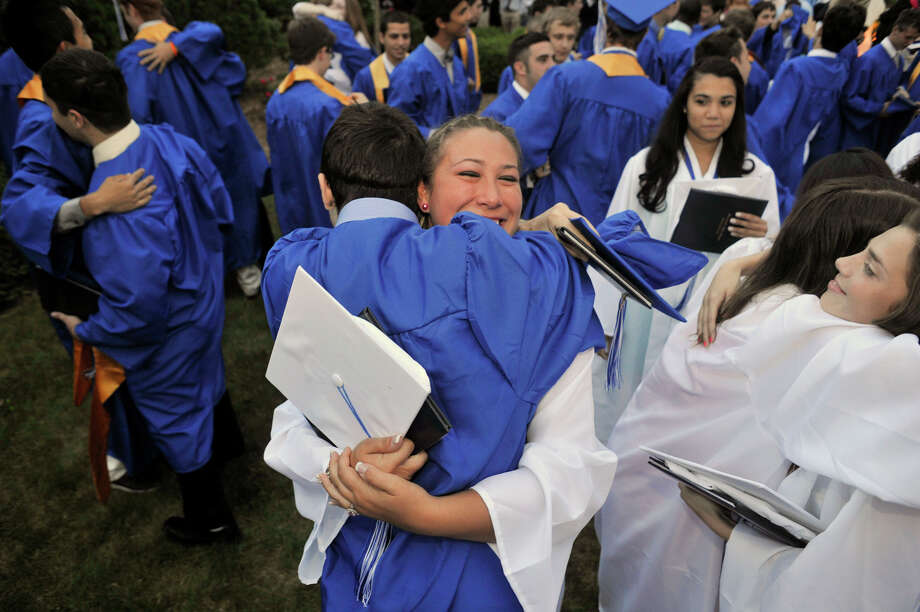 Victoria Mathews, of Danbury, hugs Michael Corning, of Brookfield, after the Immaculate High School graduation ceremony at Church of St. Mary in Bethel, Conn., on Wednesday, June 6, 2012. Photo: Jason Rearick / The News-Times