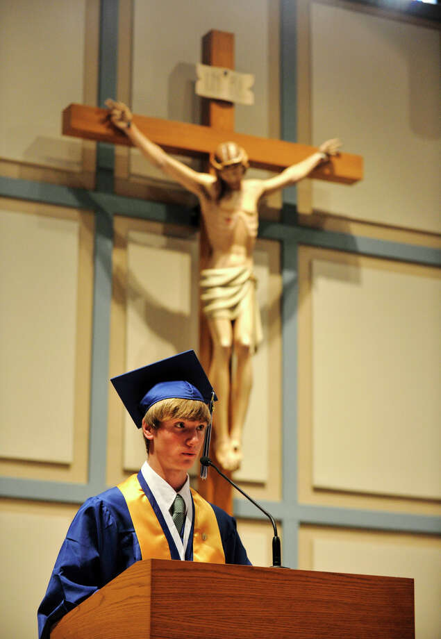 Joseph Collins gives the valedictorian address during the Immaculate High School graduation ceremony at Church of St. Mary in Bethel, Conn., on Wednesday, June 6, 2012. Photo: Jason Rearick / The News-Times