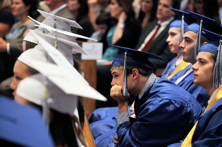 Chris Nolan, of Danbury, listens the valedictorian speak during the Immaculate High School graduation ceremony at Church of St. Mary in Bethel, Conn., on Wednesday, June 6, 2012. Photo: Jason Rearick / The News-Times