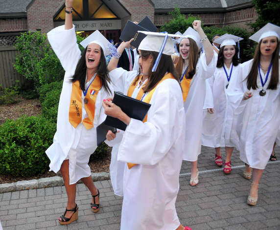 Katie Olyha, left, celebrates with her 2012 graduating class after the Immaculate High School graduation ceremony at Church of St. Mary in Bethel, Conn., on Wednesday, June 6, 2012. Photo: Jason Rearick / The News-Times