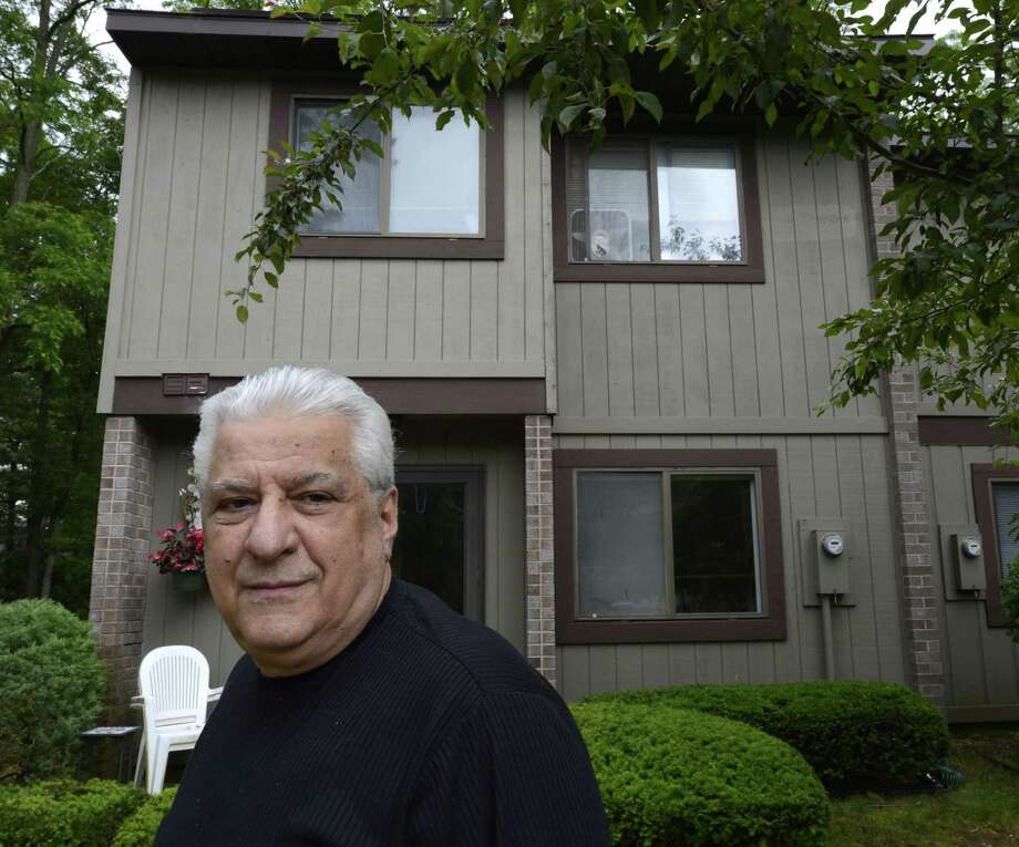 Mike Urgo, owner of a decades-old downtown Albany pizza business, stands in front of his home in Point of Woods in Albany, N.Y., June 5, 2012. (Skip Dickstein / Times Union) Photo: Skip Dickstein / 00017955A