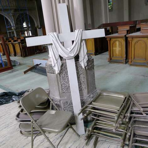 Religious icons and fixtures being salvaged from St. Patrick's Church in Watervliet N.Y. Friday April 27, 2012. (Michael P. Farrell/Times Union) Photo: Michael P. Farrell / 10017465A