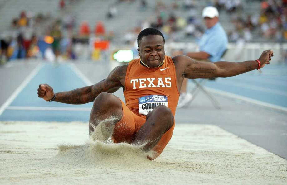 UT's Marquise Goodwin lands in the pit during the long jump at the NCAA meet. Goodwin won with a leap of 27 feet. Photo: Charlie Neibergall, Associated Press