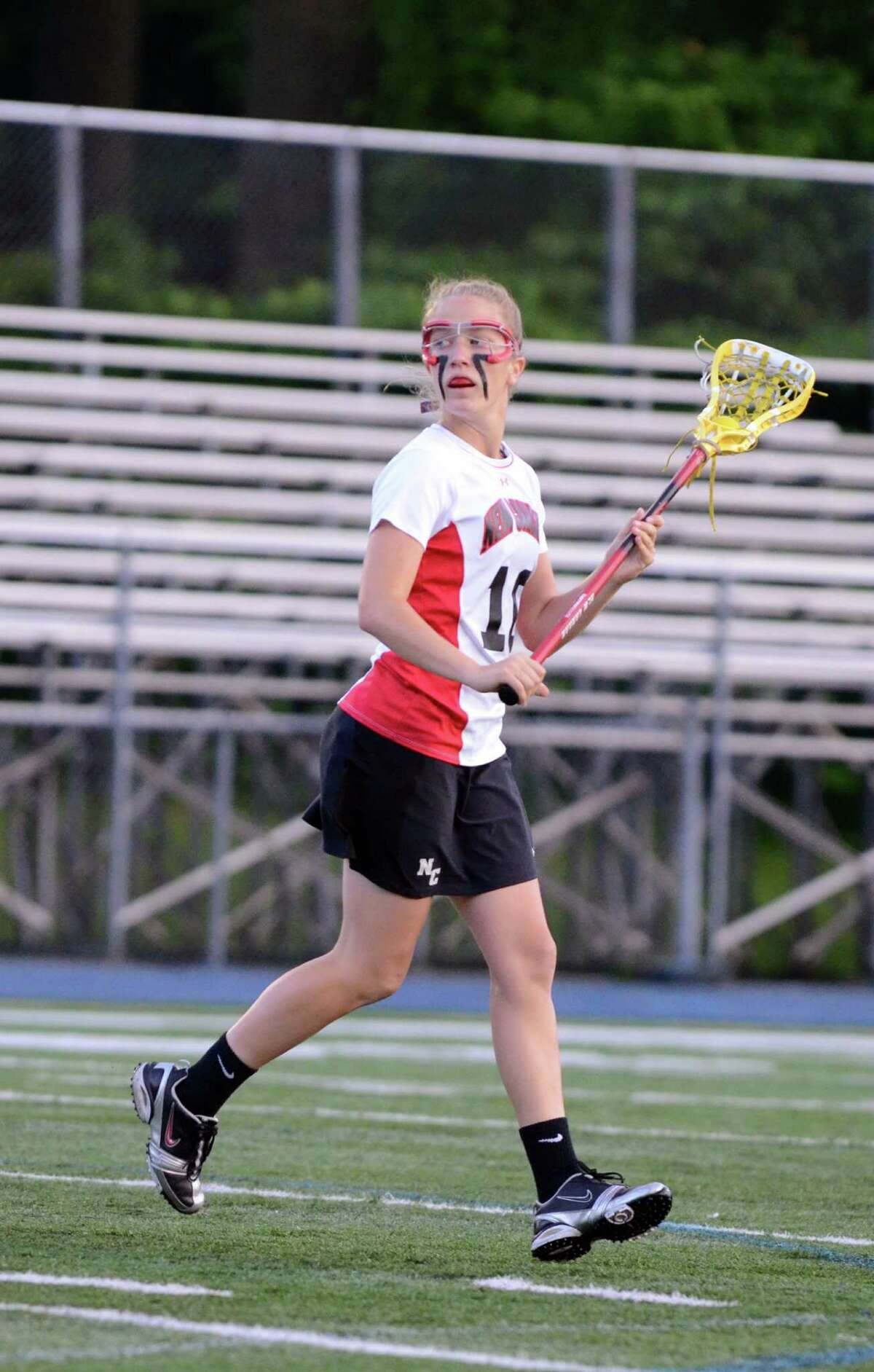 New Canaan's Sarah Mannelly (10) controls the ball during the girls lacrosse Class M semifinals against New Fairfield at Bunnell High School in Stratford on Wednesday, June 6, 2012.