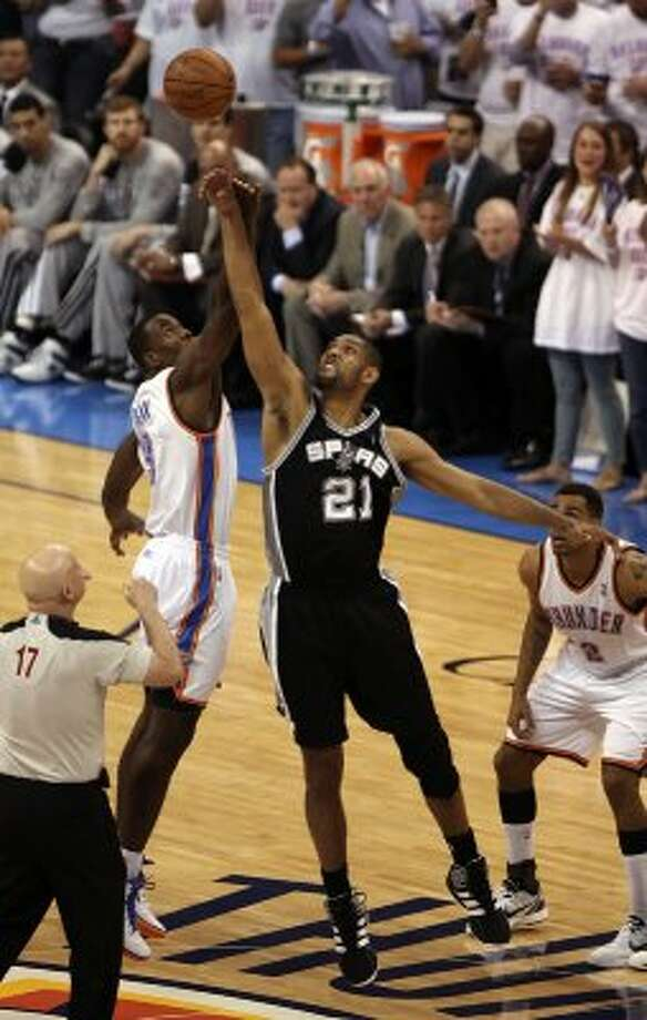San Antonio Spurs' Tim Duncan (21) tips off against Oklahoma City Thunder's Serge Ibaka (9) during the first half of game six of the NBA Western Conference Finals in Oklahoma City, Okla. on Wednesday, June 6, 2012. (Kevin Martin  / San Antonio Express-News)