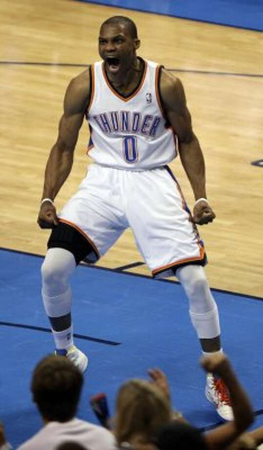 Oklahoma City Thunder's Russell Westbrook (0) reacts after a dunk during the first half of game six of the NBA Western Conference Finals in Oklahoma City, Okla. on Wednesday, June 6, 2012. (Kevin Martin / San Antonio Express-News)