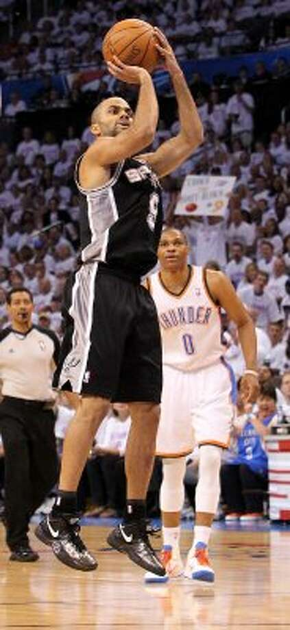 San Antonio Spurs' Tony Parker (9) shoots in front of Oklahoma City Thunder's Russell Westbrook (0) during the first half of game six of the NBA Western Conference Finals in Oklahoma City, Okla. on Wednesday, June 6, 2012. (Kin Man Hui / San Antonio Express-News)
