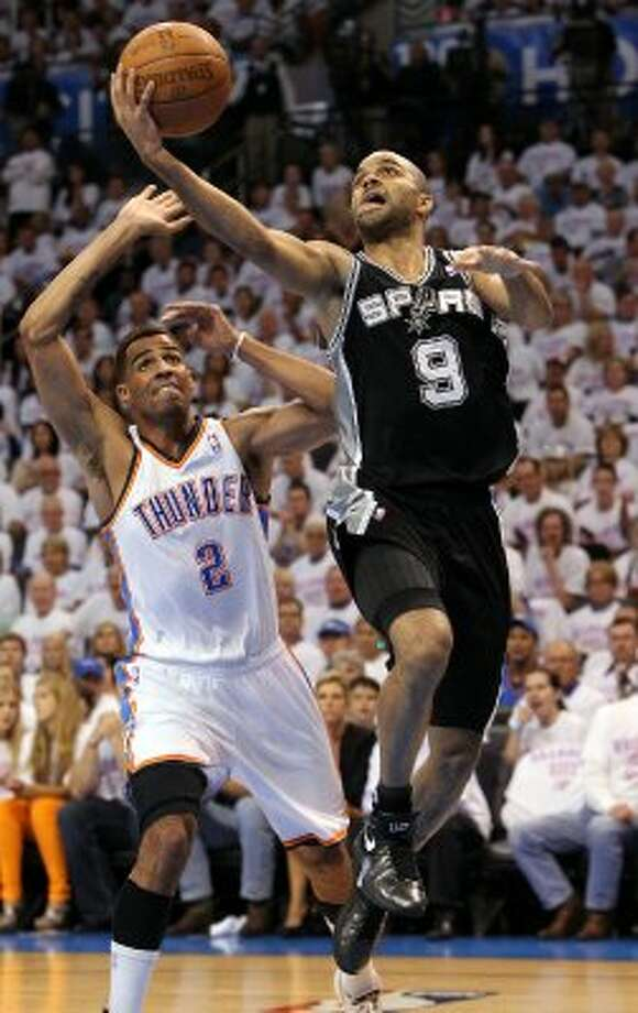 San Antonio Spurs' Tony Parker (9) goes to the basket against Oklahoma City Thunder's Thabo Sefolosha (2) during the first half of game six of the NBA Western Conference Finals in Oklahoma City, Okla. on Wednesday, June 6, 2012. (Kin Man Hui / San Antonio Express-News)