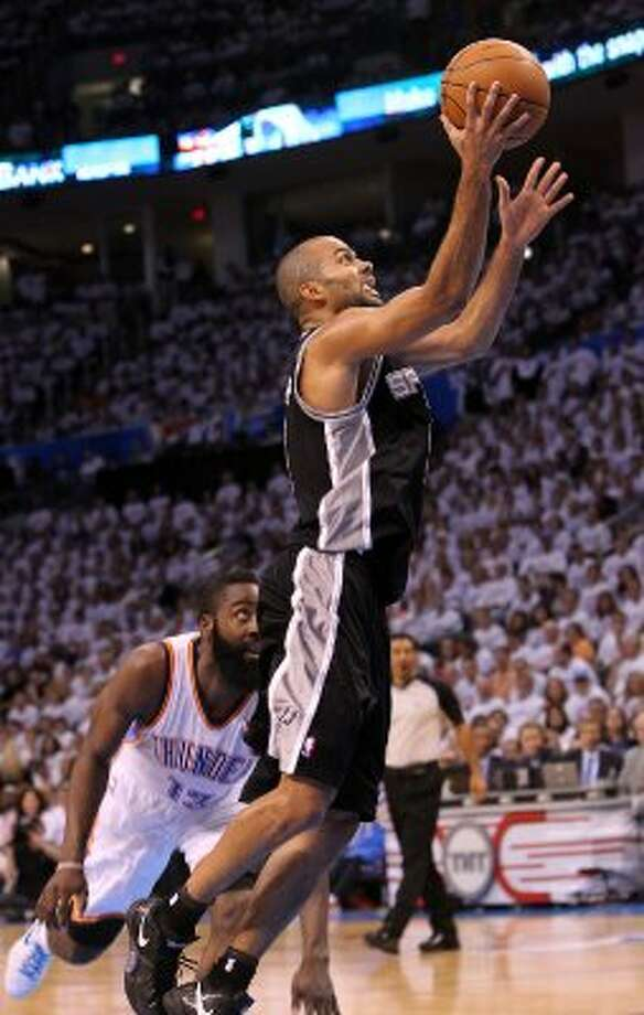 San Antonio Spurs' Tony Parker (9) drives past Oklahoma City Thunder's James Harden (13) during the first half of game six of the NBA Western Conference Finals in Oklahoma City, Okla. on Wednesday, June 6, 2012. (Kin Man Hui / San Antonio Express-News)