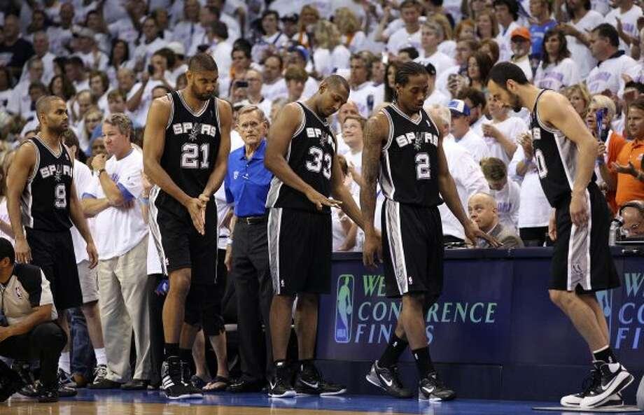 San Antonio Spurs' Tony Parker (9), Tim Duncan (21), Boris Diaw (33), Kawhi Leonard (2) and Manu Ginobili (20) check in before the first half of game six of the NBA Western Conference Finals in Oklahoma City, Okla. on Wednesday, June 6, 2012. (Jerry Lara / San Antonio Express-News)