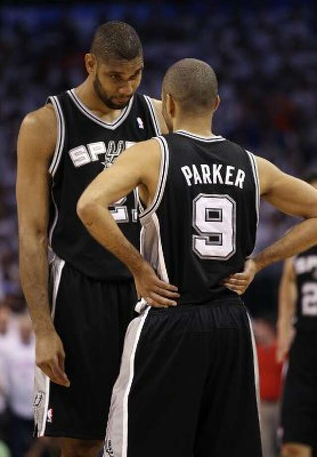 San Antonio Spurs' Tim Duncan (21) talks to San Antonio Spurs' Tony Parker (9) before the first half of game six of the NBA Western Conference Finals in Oklahoma City, Okla. on Wednesday, June 6, 2012. (Jerry Lara / San Antonio Express-News)