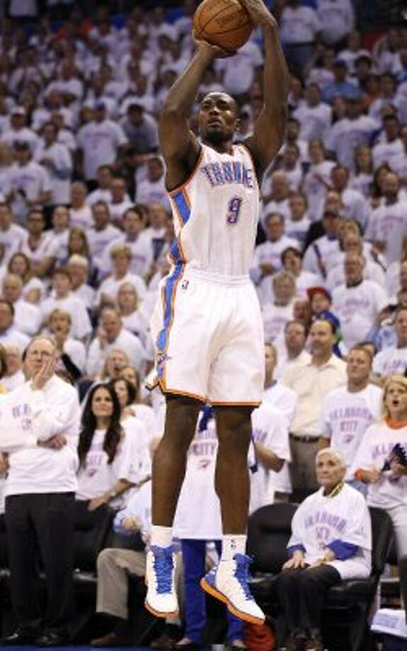 Oklahoma City Thunder's Serge Ibaka (9) shoots during the first half of game six of the NBA Western Conference Finals in Oklahoma City, Okla. on Wednesday, June 6, 2012. (Jerry Lara / San Antonio Express-News)