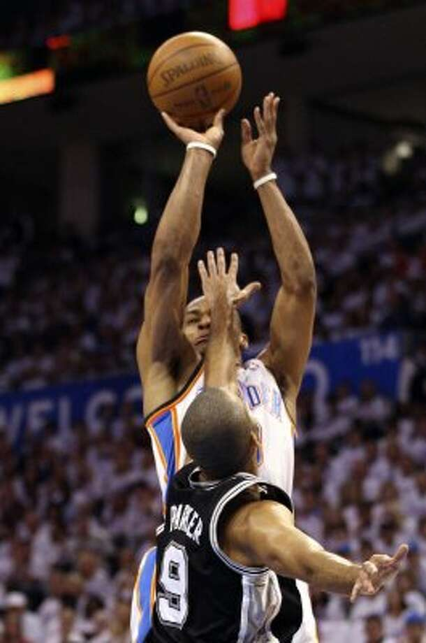 Oklahoma City Thunder's Russell Westbrook (0) shoots over San Antonio Spurs' Tony Parker (9) during the first half of game six of the NBA Western Conference Finals in Oklahoma City, Okla. on Wednesday, June 6, 2012. (Jerry Lara / San Antonio Express-News)