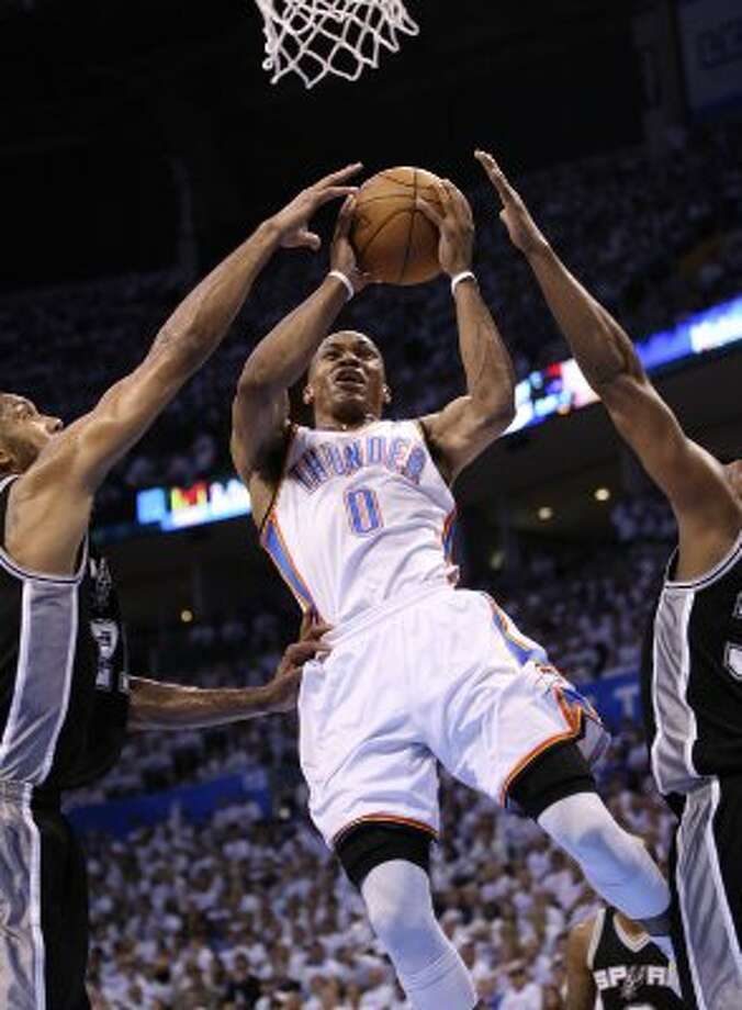 Oklahoma City Thunder's Russell Westbrook (0) shoots against San Antonio Spurs' Tim Duncan (21) during the first half of game six of the NBA Western Conference Finals in Oklahoma City, Okla. on Wednesday, June 6, 2012. (Jerry Lara / San Antonio Express-News)
