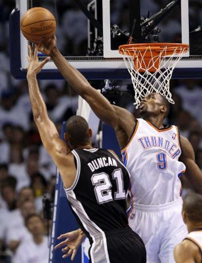 Oklahoma City Thunder's Serge Ibaka (9) blocks a shot by San Antonio Spurs' Tim Duncan (21) during the first half of game six of the NBA Western Conference Finals in Oklahoma City, Okla. on Wednesday, June 6, 2012. (Jerry Lara / San Antonio Express-News)