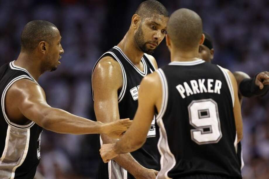 San Antonio Spurs' Tim Duncan (21) in a huddle with San Antonio Spurs' Boris Diaw (33) and San Antonio Spurs' Tony Parker (9) during the first half of game six of the NBA Western Conference Finals in Oklahoma City, Okla. on Wednesday, June 6, 2012. (Jerry Lara / San Antonio Express-News)