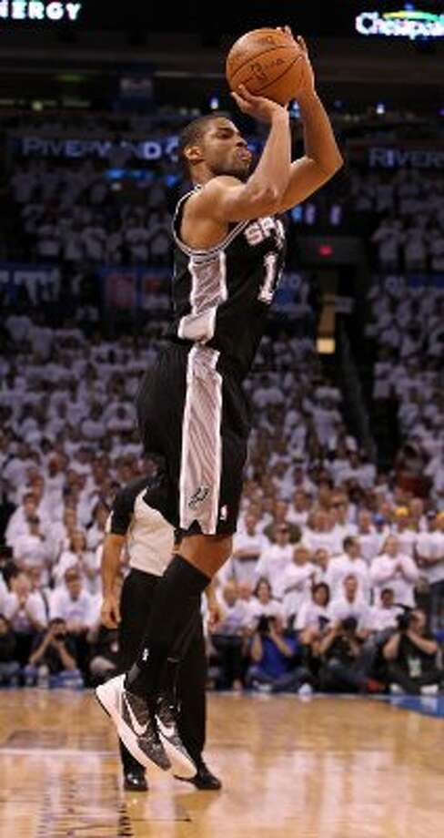 San Antonio Spurs' Gary Neal (14) shoots during the first half of game six of the NBA Western Conference Finals in Oklahoma City, Okla. on Wednesday, June 6, 2012. (Kin Man Hui / San Antonio Express-News)
