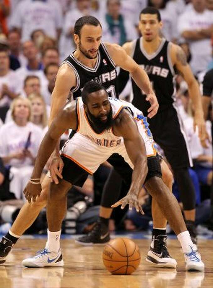 San Antonio Spurs' Manu Ginobili (20) guards Oklahoma City Thunder's James Harden (13) during the first half of game six of the NBA Western Conference Finals in Oklahoma City, Okla. on Wednesday, June 6, 2012. (Kin Man Hui / San Antonio Express-News)