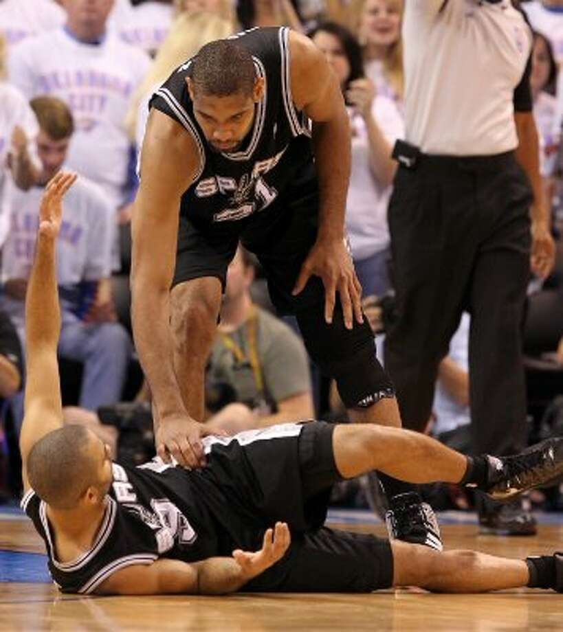 San Antonio Spurs' Tim Duncan (21) checks on San Antonio Spurs' Tony Parker (9) during the first half of game six of the NBA Western Conference Finals in Oklahoma City, Okla. on Wednesday, June 6, 2012. (Kin Man Hui / San Antonio Express-News)