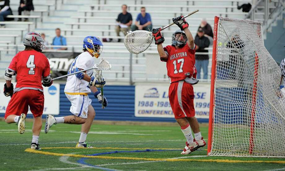 West Islip's Brendan Smith scores past Niskayuna goalkeeper Evan Quinn in the New York State Class A boys lacrosse semi-final game. (June 6, 2012)  PHOTO CREDIT:  KATHLEEN MALONE-VAN DYKE Photo: Kathleen Malone-Van Dyke / © 2012 Kathleen Malone-Van Dyke