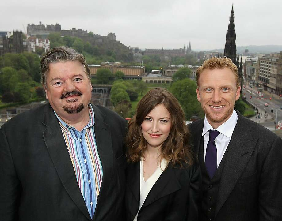 EDINBURGH, SCOTLAND - MAY 30:  Robbie Coltrane (voice of Lord Dingwall), Kelly Macdonald (voice of Merida) and Kevin McKidd (voice of Lord MacGuffin) pose for a photograph at the global press event for Disney Pixar's 'Brave' on May 30, 2012 in Edinburgh, Scotland.  (Photo by Chris Jackson/Getty Images for Disney) Photo: Chris Jackson, Getty Images For Disney