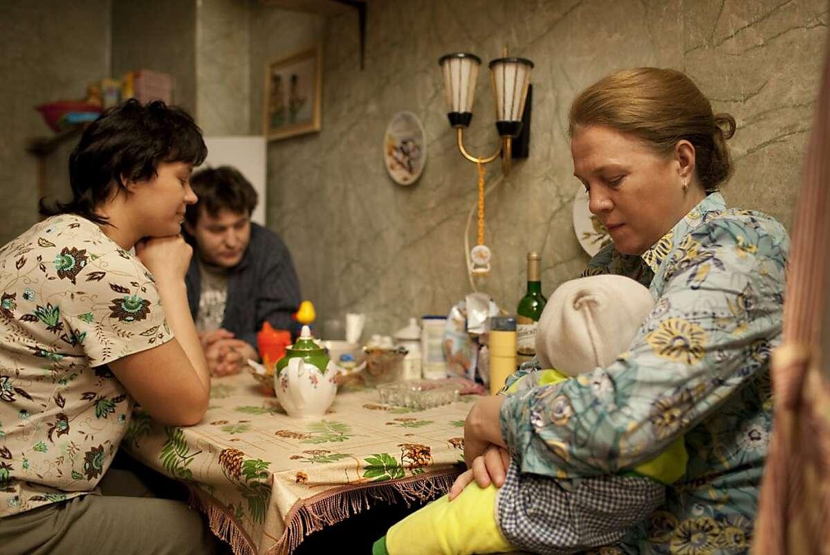 Alexey Rozin as Sergey, Evgenia Konushkina as Tatyana and Nadezhda Markina as Elena in ELENA, a film by Andrei Zvyagintsev. A Zeitgeist Films release.