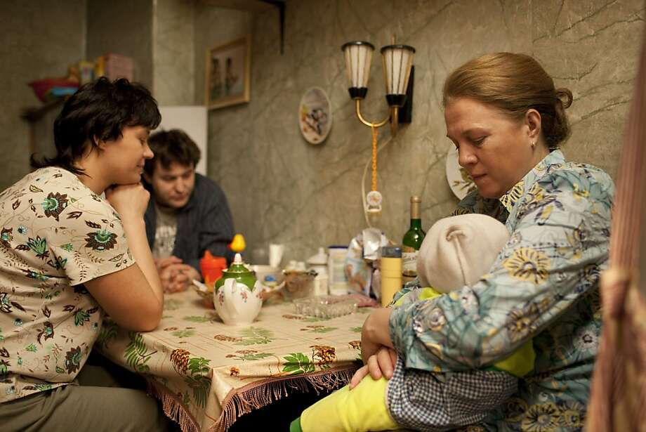 Alexey Rozin as Sergey, Evgenia Konushkina as Tatyana and Nadezhda Markina as Elena in ELENA, a film by Andrei Zvyagintsev. A Zeitgeist Films release. Photo: Zeitgeist Films