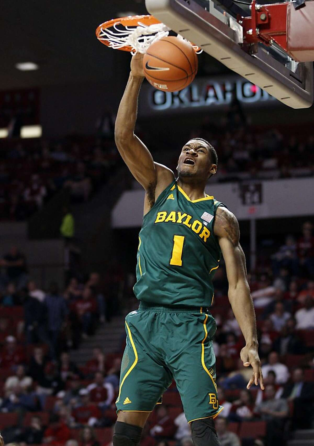 This Jan. 24, 2012 file photo shows Baylor forward Perry Jones III dunking against Oklahoma in the first half of an NCAA college basketball game in Norman, Okla.. (AP Photo/Sue Ogrocki,File)