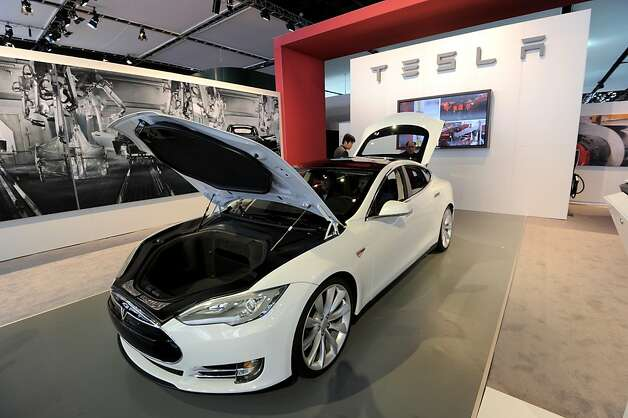 "(FILES) This January 10, 2012 file photo shows the Tesla Model S electric car on display during the second press preview day at the 2012 North American International Auto Show in Detroit, Michigan. Tesla Motors said May 22, 2012 it would begin deliveries of ""the world's first premium electric sedan"" on June 22, slightly ahead of schedule. Several customers will receive their cars that day at an invitation-only event at the Tesla Factory in Fremont, California, said the company created in 2003 by Elon Musk, a co-founder of PayPal and SpaceX. The company, which already markets a sports car at more than $100,000, will be launching the Model S, starting at $49,900, which is described as ""the first premium sedan designed from the ground up to take full advantage of electric vehicle architecture."" AFP PHOTO/Stan HONDA/FILESSTAN HONDA/AFP/GettyImages Photo: Stan Honda, AFP/Getty Images"