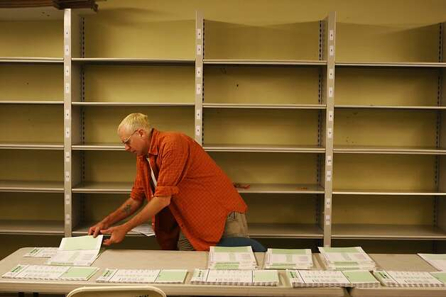 Russell Gammon, a temporary clerk, sorts header cards to organize ballots from the previous nights' election at City Hall on Wednesday, June 6, 2012 in San Francisco, Calif. Photo: Pete Kiehart, The Chronicle