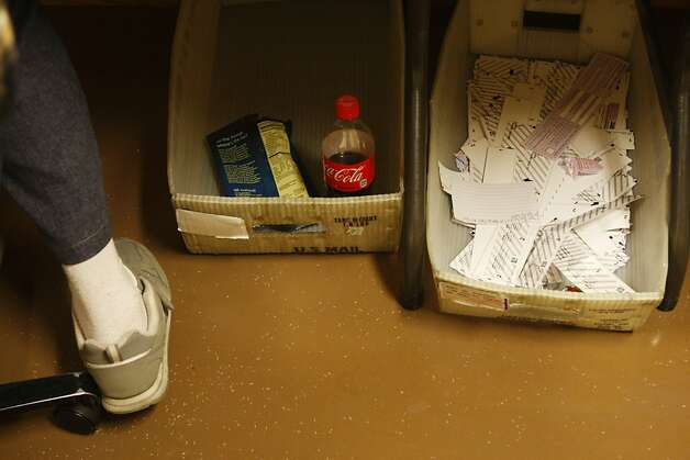 Snacks are stored under a desk while clerks sort and count ballots at City Hall on Wednesday, June 6, 2012 in San Francisco, Calif. Photo: Pete Kiehart, The Chronicle