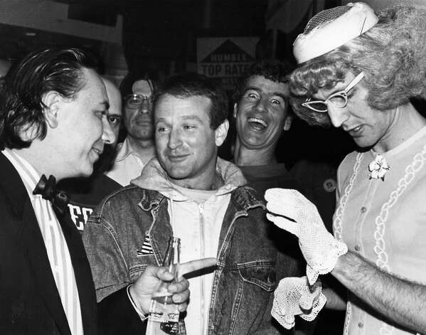 """Robin Williams (1987): I found a few photos of Williams from earlier in the 1980s, but I like this one the best. He's with Will Durst (left) after Durst lost his run for mayor. Pretty sure that's Vera Carp of """"Greater Tuna"""" on the right. Photo: Chronicle Archives"""