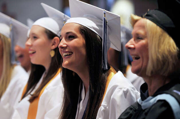 Katie Olyha, of New Fairfield, left, laughs during Immaculate High School graduation at Church of St. Mary in Bethel, Conn., on Wednesday, June 6, 2012. Photo: Jason Rearick / The News-Times