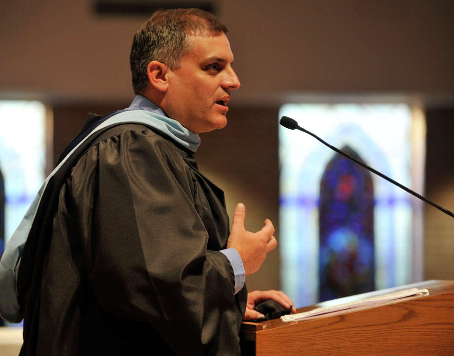 Principal Joseph Carmen speaks during the Immaculate High School graduation ceremony at Church of St. Mary in Bethel, Conn., on Wednesday, June 6, 2012. Photo: Jason Rearick / The News-Times